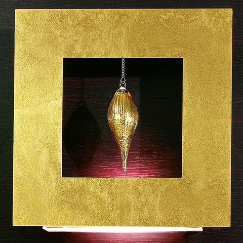Gold leaf wall light with single gold glass drop