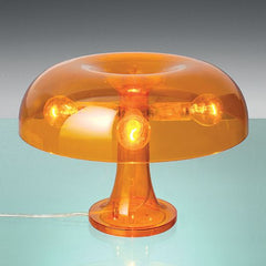 Nessino orange or white polycarbonate lamp from Artemide