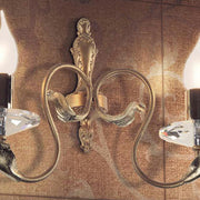 Hand-forged gold metal wall light with crystal candle cups