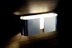 Sleek modern white or chrome designer wall light