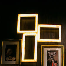 Quirky and unusual triple picture frame style light in a neutral marble colour