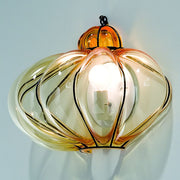 Amber Murano glass wall light on a black nickel frame