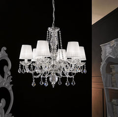 Four light lead crystal chandelier featuring the Leonardo system