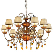 Antiqued gold and amber chandelier with cream coloured shades