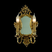Ornamental mirror with two beautiful candle-style lights
