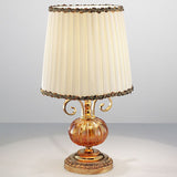 Small Amber glass table lamp with gold frame
