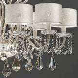 Ten arm crystal chandelier with white lace shades