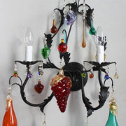 Black metal wall light with coloured Venetian glass fruits