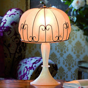 Venetian table lamp with amber glass shade and base