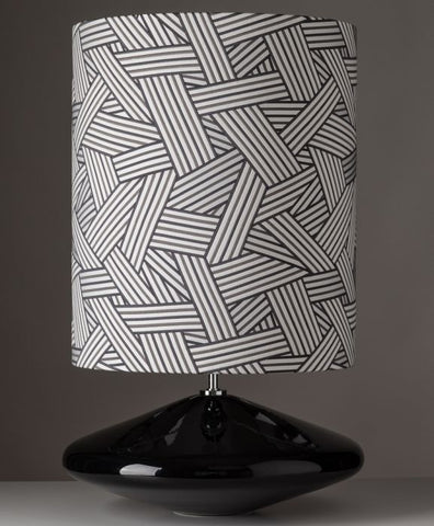 Black or white lamp with geometric design shade