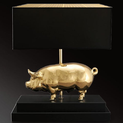 24 carat gold 'lucky pig' table light with black shade