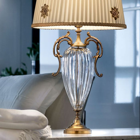 Gold and clear glass table lamp with decorative shade