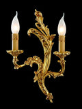 Ornamental cast brass and gold wall candelabra