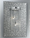 Swarovski crystal wall light on a decorative smoked glass mirror