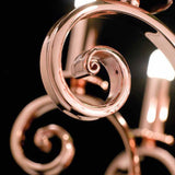 Modern iron chandelier with shiny copper finish