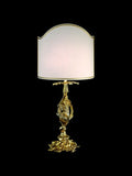 Ornate table light with 24 carat gold plating and white shade