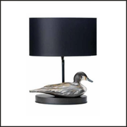 Black table lamp with silver duck