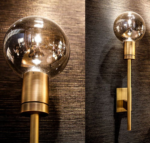 Bronze wall light with exposed bulb and  shiny flecks