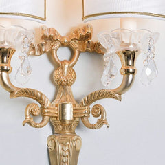 Ornate wall light with clear crystal bobeches and pendants