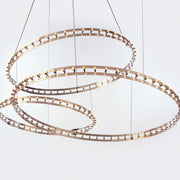 Circular  metal suspended designer light for lone or modular use