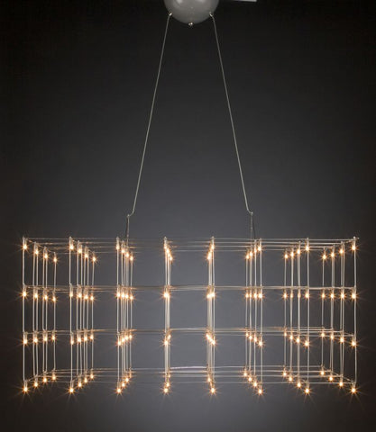 Large modern metal cage light seen at Cavalli Milan