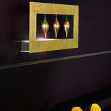 Gold leaf wall light with three gold glass drops