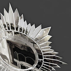 Silvered sun-burst wall mirror in the art deco style