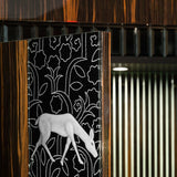 Ebony and glass cabinet with reindeer motif