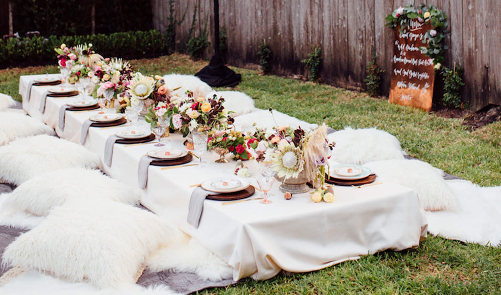 Boho backyard baby shower setting