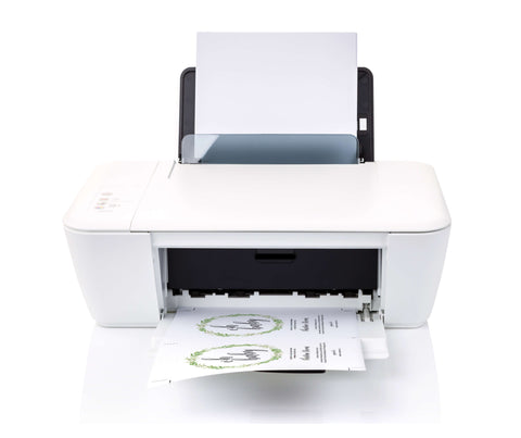White printer printing a greenery baby shower invitation