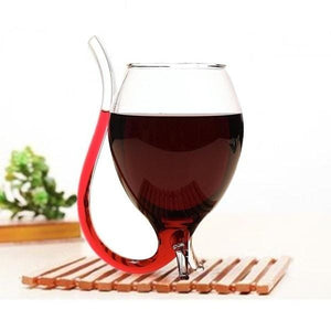wine glass with built in straw red white rose on wood plate