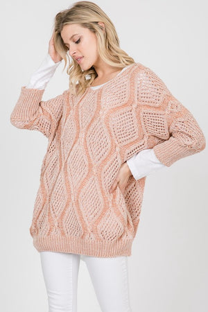 Loose knit cable knit sweater.