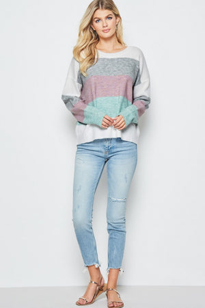 This colorblock sweater is ultra soft wool blend in different shades of colors! Super trendy, chic, and comfy! Slightly oversized fit with round neckline.