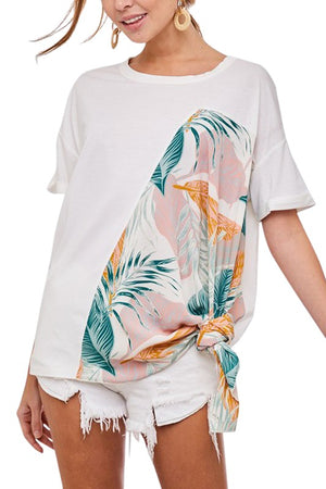 A short sleeve top with floral contrast and side tie.   This tropical print is perfect for summer!