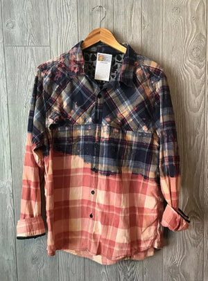 Our vintage flannels are hand selected, acid washed to look like individual pieces of art, washed, softened and pre-shrunk.  Throughout the process we use lavender essential oils.     100% cotton.