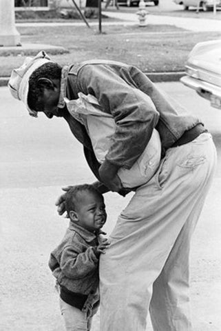 African American Man with Crying Child, 1962 by McMahan Photo Archive