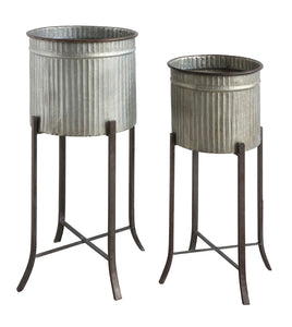 "13-1/2"" Round x 30-3/4""H & 11-3/4"" Round x 27""H Corrugated Metal Planters w/ Stand, Set of 2 (Holds 12"" & 10"" Pots)"