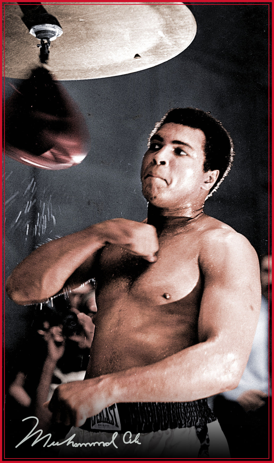 An image of Ali punching a bag with his signature in the bottom corner.