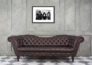The Black Sabbath print modeled over a plush couch.