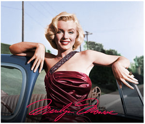 Marilyn Monroe relaxes against a car door wearing a red gown.