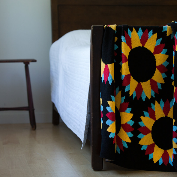 black recycled cotton throws and blankets with sunflower print, designed by Artist Ryan Cronin