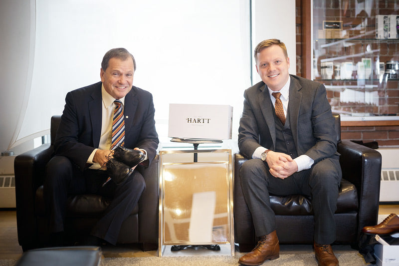 Frank McKenna (left) poses for a photo with, CEO of the Hartt Shoe Company Andrew Bedford.
