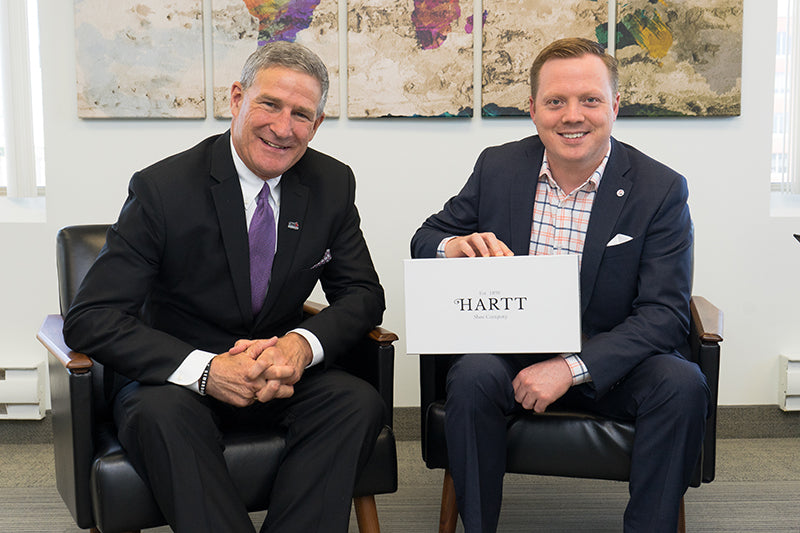 CEO and Deputy Minister of Opportunities New Brunswick, Steven Lund (left) poses for a photo with Hartt Shoe Company CEO, Andrew Bedford.