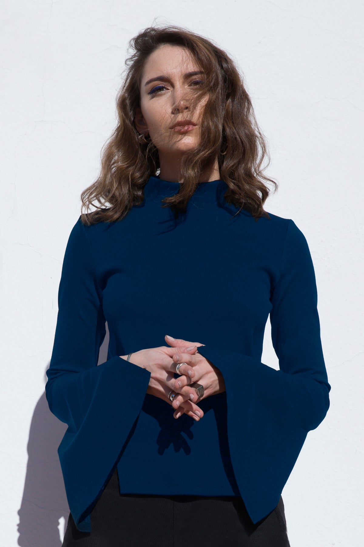 Knit Top With High Fitting Collar And Open Sleeves