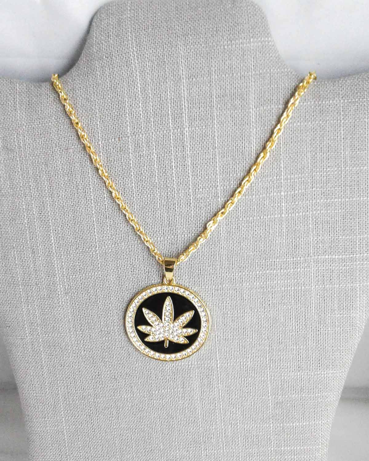 black and gold pot leaf pendant with rhinestones