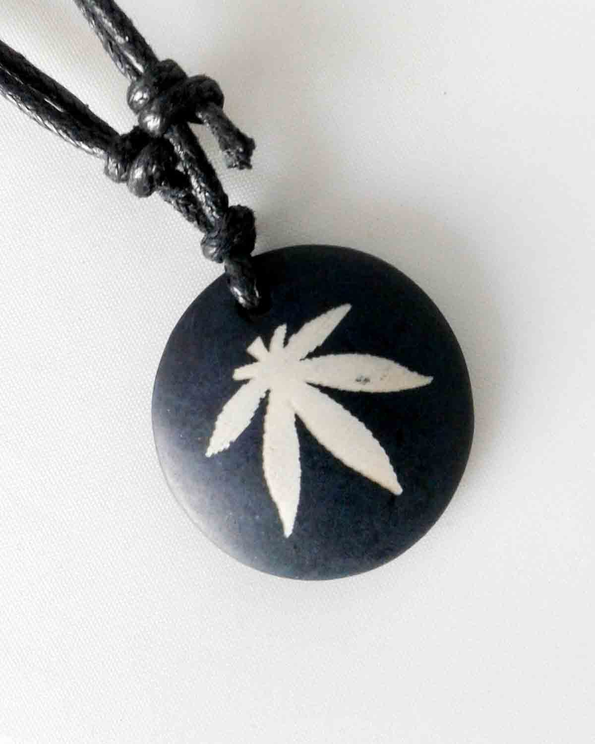 black and white pot leaf necklace