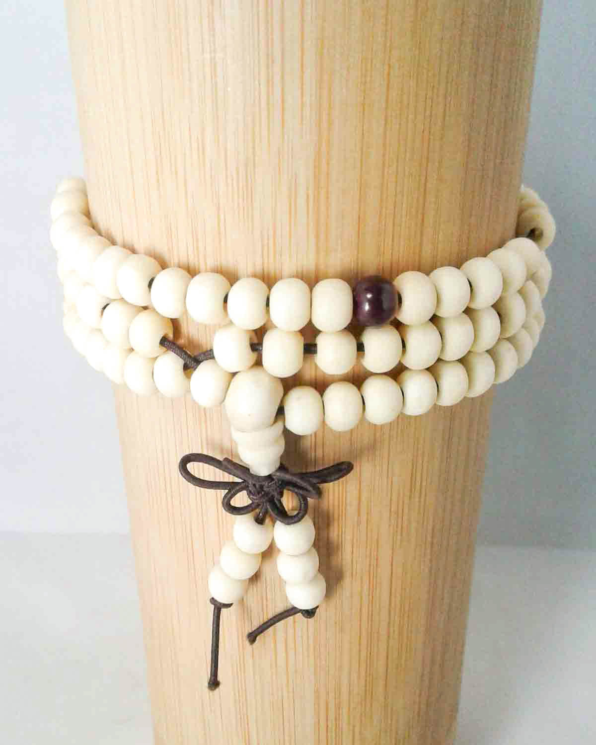 white 108 bead mala bracelet with tassel