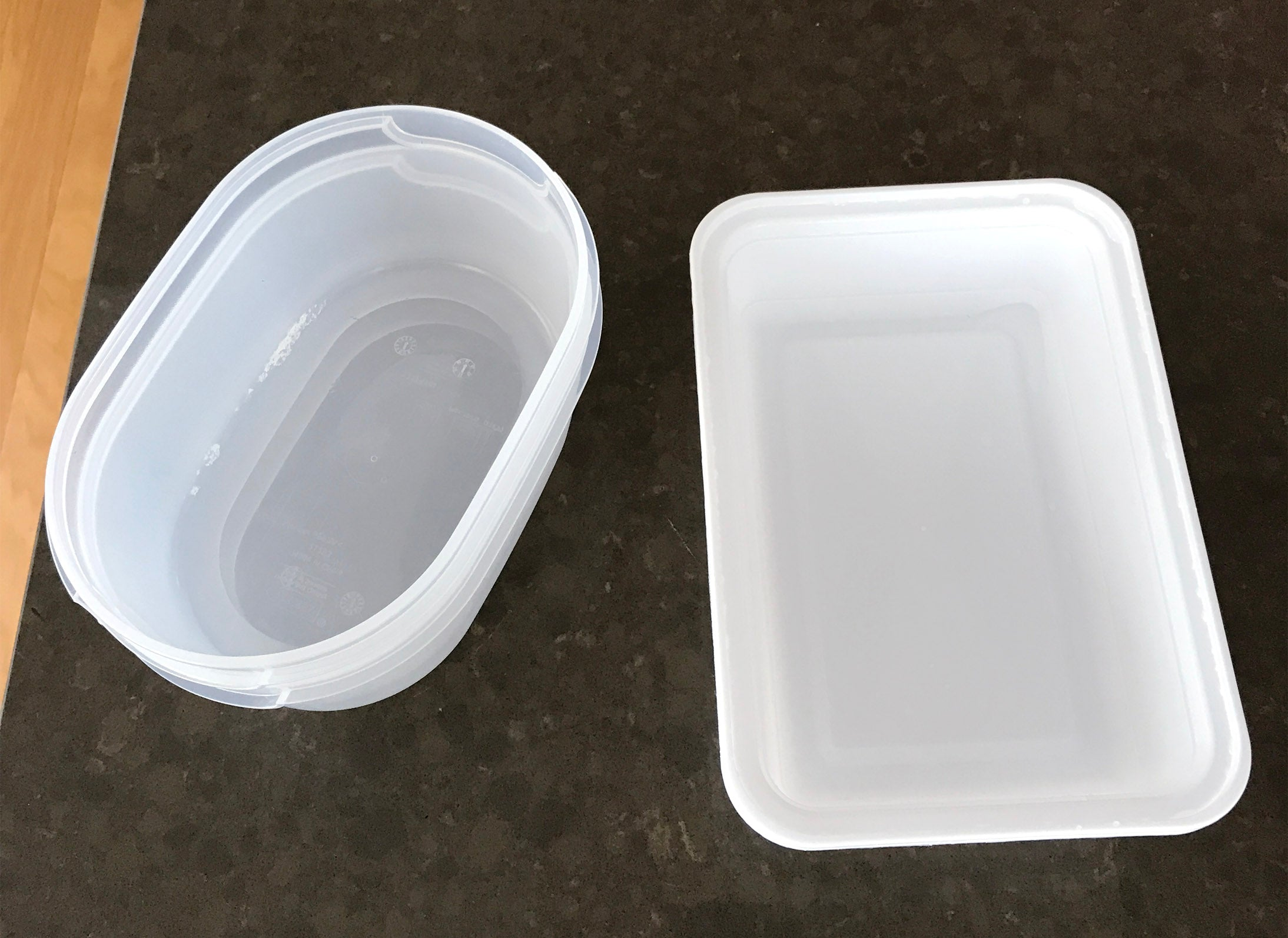 Two plastic containers for food side by side