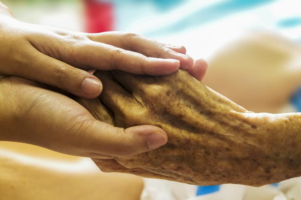 hand holding care for old hospital cremation