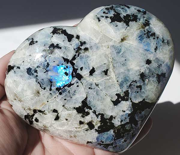 Moonstone can be purchased as raw stones or with a polished finish in sphere, heart, and tower shapes.